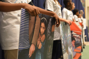 On 19 September 2016, children from the East side Middle School and P.S 119 Amersfort hold pictures of refugee and migrant children as they greet world leaders entering the General Assembly Hall to remind them to prioritize the rights of children during the high level plenary on refugees and migrant at the United Nations Headquarters in New York City.On the morning of the United NationsÕ first ever summit on refugees and migrants, the U.S. Fund for UNICEF and others are reminding world leaders to put #ChildrenFirst as they address the largest humanitarian crisis of displacement since World War II.  An estimated 50 million children have been uprooted from their homes by conflict, violence, poverty, extreme weather and drought. Though many things divide nations and peoples, most can agree that children are innocent and deserve the opportunity to grow to their full potential. Though called by many names - refugees, migrants, stateless, internally displaced - they are children first.