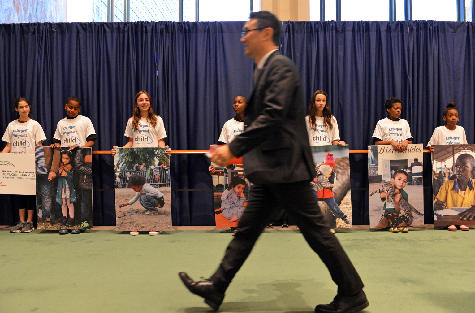 On 19 September 2016, children from the East side Middle School and P.S 119 Amersfort hold pictures of refugee and migrant children as they greet world leaders entering the General Assembly Hall to remind them to prioritize the rights of children during the high level plenary on refugees and migrant at the United Nations Headquarters in New York City.On the morning of the United Nations? first ever summit on refugees and migrants, the U.S. Fund for UNICEF and others are reminding world leaders to put #ChildrenFirst as they address the largest humanitarian crisis of displacement since World War II.  An estimated 50 million children have been uprooted from their homes by conflict, violence, poverty, extreme weather and drought. Though many things divide nations and peoples, most can agree that children are innocent and deserve the opportunity to grow to their full potential. Though called by many names - refugees, migrants, stateless, internally displaced - they are children first.