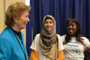 On 19 September 2016, (left-right) Mary Robinson, President of the Mary Robinson Foundation - Climate Justice, speaks with Irish Youth Ambassador Minahil Sarfraz, a refugee youth activist from Pakistan and Irish Youth Ambassador Natasha Esther Maimba, a refugee youth activist from Zimbabwe as children from the East side Middle School and P.S 119 Amersfort hold pictures of refugee and migrant children as they greet world leaders entering the General Assembly Hall to remind them to prioritize the rights of children during the high level plenary on refugees and migrant at the United Nations Headquarters in New York City.  On the morning of the United NationsÕ first ever summit on refugees and migrants, the U.S. Fund for UNICEF and others are reminding world leaders to put #ChildrenFirst as they address the largest humanitarian crisis of displacement since World War II.  An estimated 50 million children have been uprooted from their homes by conflict, violence, poverty, extreme weather and drought. Though many things divide nations and peoples, most can agree that children are innocent and deserve the opportunity to grow to their full potential. Though called by many names - refugees, migrants, stateless, internally displaced - they are children first.
